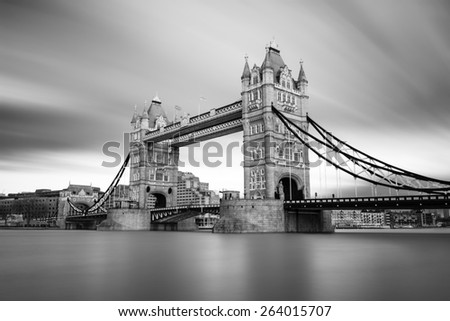 Black and white photograph of London Tower Bridge on the Thames River. It is an iconic symbol of London, United Kingdom. - stock photo