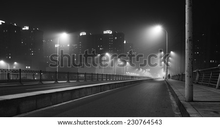 Black and white photograph taken in Shanghai a day of big pollution. - stock photo