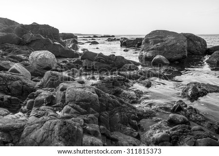 black and white photography of rocky coast of Black sea, Bulgaria - stock photo
