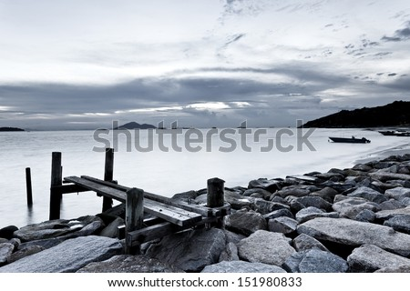 Black and white photography of sky and sea at sunset - stock photo