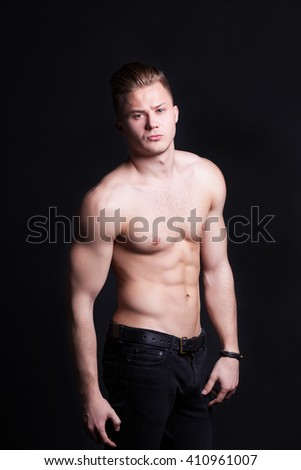 Black and white photos of the handsome and muscular man in underwear who has a mysterious look - stock photo