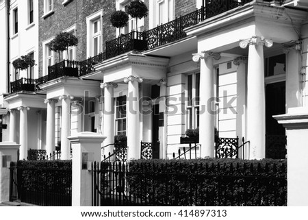 Black and white picture of old fashioned typical Regency Georgian terraced town houses building architecture in fashionable Notting Hill, Kensington, London, England, UK - stock photo