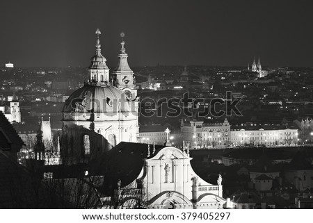 Black and white picture of Saint Nicolas church in Prague. Landscape Picture night Prague from the castle, one of the most beautiful baroque churches in old town in capitol of Czech Republic Prague. - stock photo