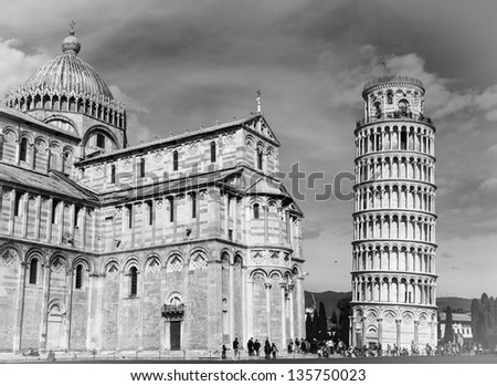 Black and white picture of the leaning tower of Pisa and cathedral - stock photo