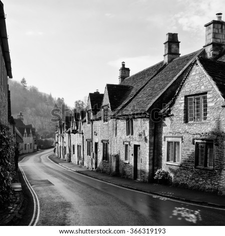 Black and White Picturesque Cotswold village of Castle Combe, England - stock photo