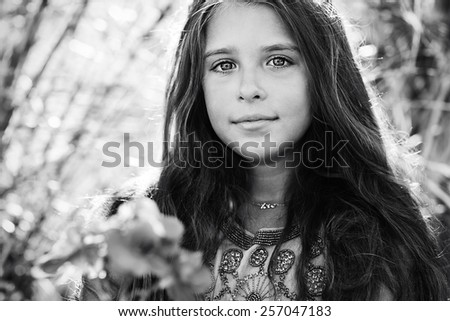 black and white portrait . girl with a beautiful eyes outdoors . - stock photo