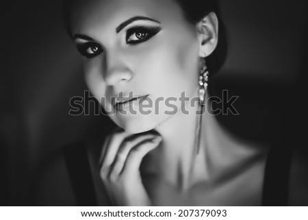 black and white portrait of a beautiful female - stock photo