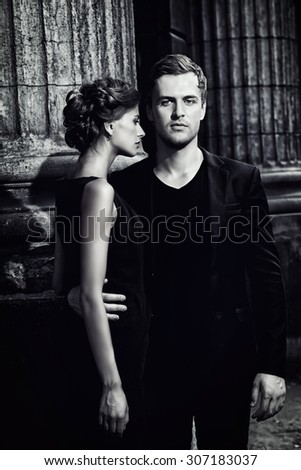 Black-and-white portrait of a beautiful man and woman. Fashion style photo. Love concept. - stock photo