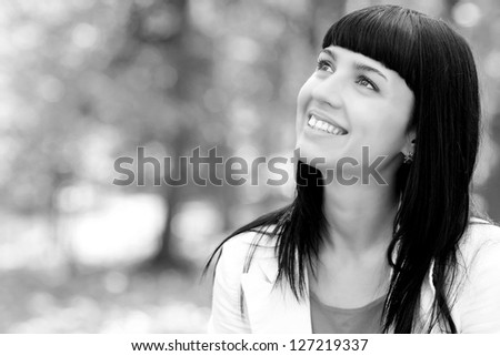 black and white portrait of a beautiful young woman in autumn forest - stock photo