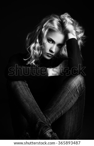 Black-and-white portrait of a calm, sad beautiful young woman looking at camera. Emotions. Beauty, fashion.  - stock photo