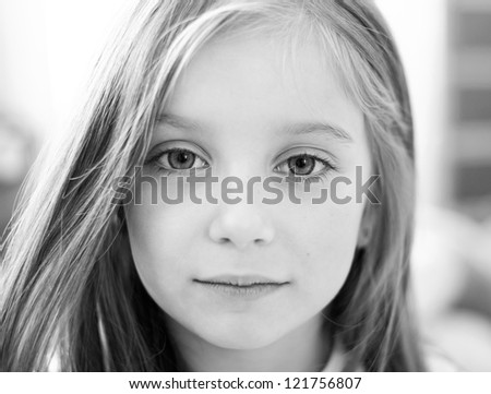 black-and-white portrait of a cute liitle girl - stock photo