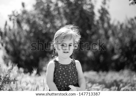 Black and white portrait of a cute little girl - stock photo