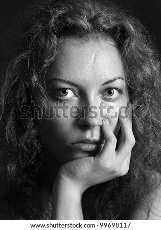 black and white portrait of a girl a woman with big eyes and curly hair - stock photo