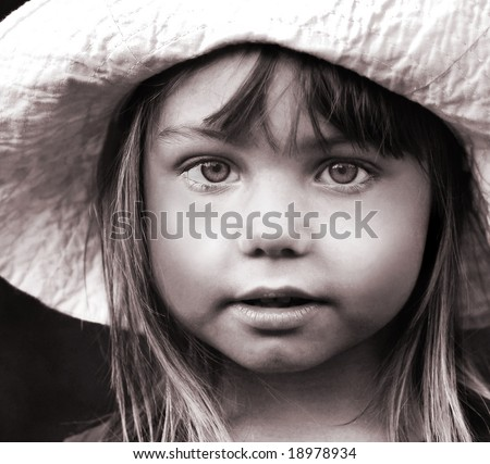 Black and white portrait of a girl in hat - stock photo