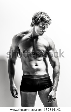 black and white portrait of a handsome caucasian male model dressed in jockey underwear - stock photo