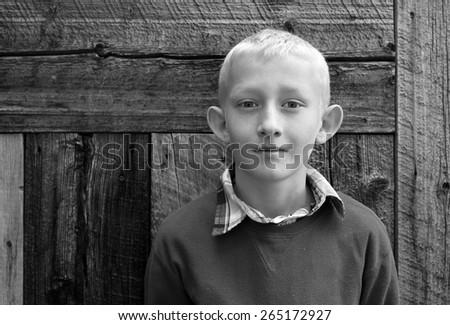 Black and white portrait of a young boy. - stock photo