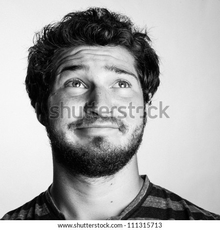 Black and White Portrait of a Young College Boy looking up to the sky - stock photo