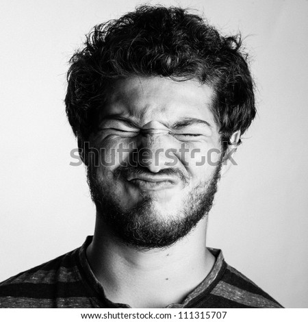 Black and White Portrait of a Young College boy wth his eyes shut - stock photo