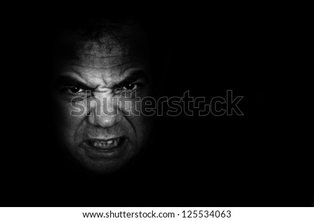 Black-and-white portrait of an angry man - stock photo