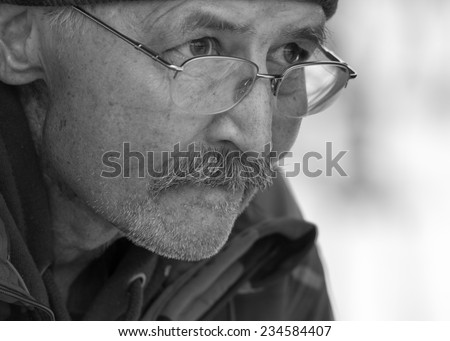 Black and white portrait of an Elderly Man looking concerned about life. - stock photo