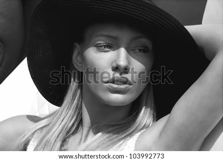 Black and white portrait of beautiful delicate woman - stock photo