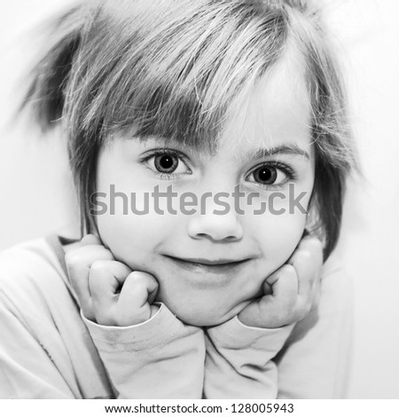 Black and white portrait of beautiful funny little girl. Selective focus on the eyes of a child. Retro style. - stock photo