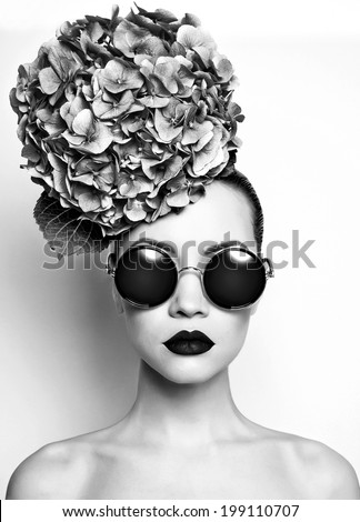 Black and white portrait of beautiful lady with hydrangea - stock photo