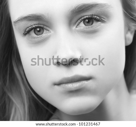Black and white portrait of beautiful young woman, close up - stock photo