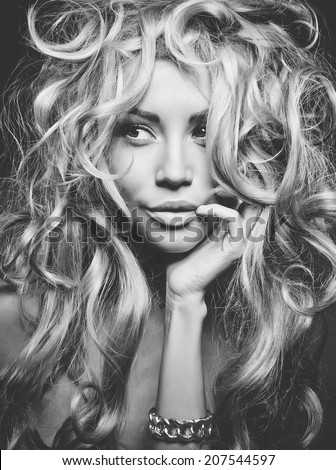 Black and white portrait of eautiful woman with magnificent blond hair. Hair extension, permed - stock photo