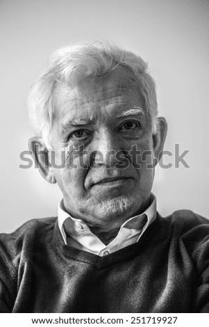 Black and white portrait of male pensioner - stock photo
