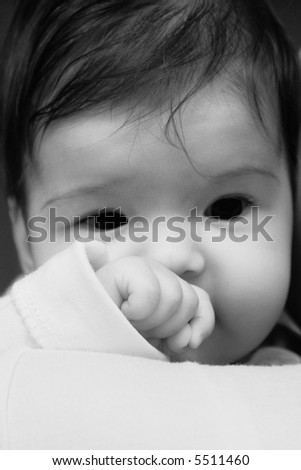 black and white portrait of pretty baby with sad expression - stock photo