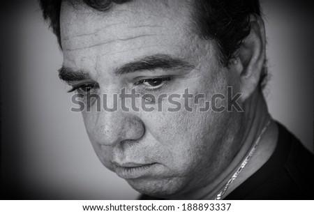 Black and white portrait of sad men.  - stock photo