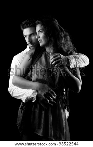 black and white portrait of two young loves embraced - stock photo