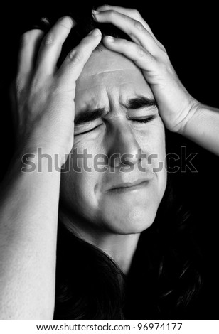 Black and white portrait of very stressed woman with a desperate or crazy expression - stock photo