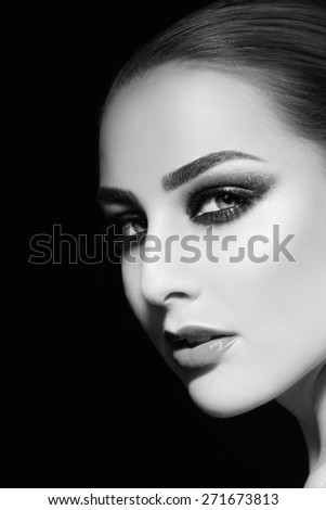 Black and white portrait of young beautiful woman with smoky eyes, copy space - stock photo