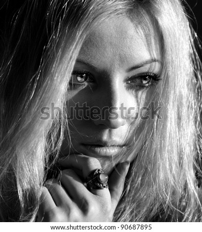 black and white portrait of young blond woman - stock photo