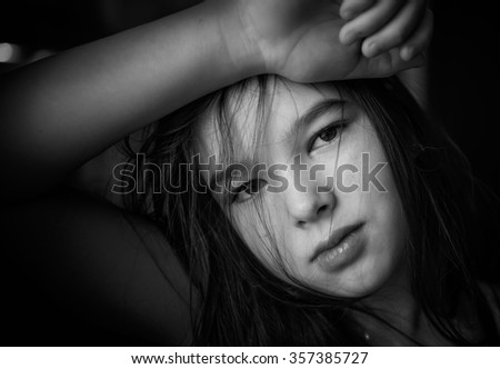 Black and white portrait. 9-10 years old teen girl - stock photo
