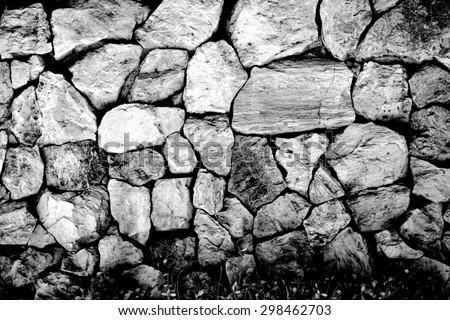 black and white rock wall texture for background used - stock photo