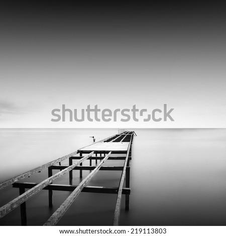 Black and white seascape with metal pier the sea, Black sea, Odessa, Ukraine - stock photo