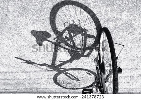 Black and white shadow of a bicycle / Shadow of a bicycle  - stock photo