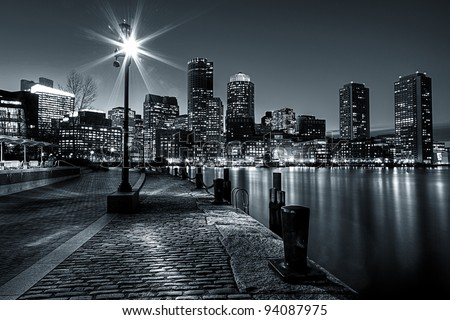 Black and White shot of Boston Harbor and Financial district in Boston, Massachusetts. - stock photo