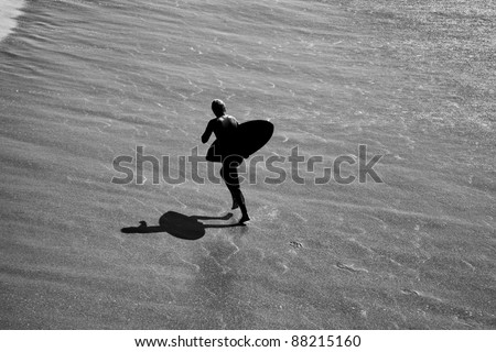 Black and White Silhouette  of Wave Boarder in Surf Newport Beach California - stock photo