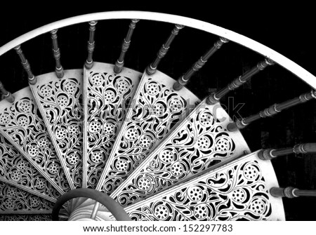 Black and white spiral stairs - stock photo