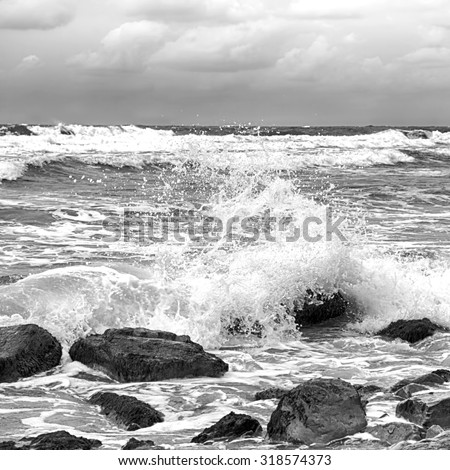 Black and white stormy sea after a rain - stock photo