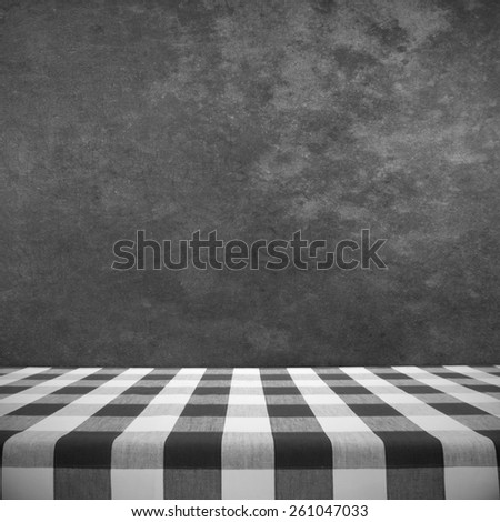 Black and white tablecloth on textured wall - stock photo