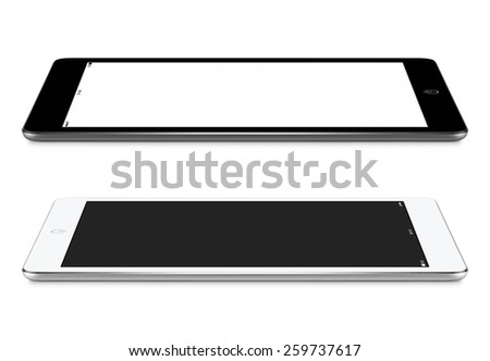 Black and white  tablet computers with blank screen mockup lie on the surface, left and right side view, isolated on white background. - stock photo