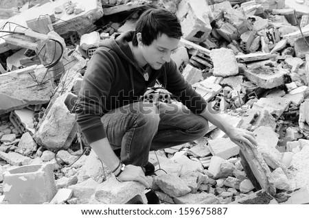Black and white take depicting hard times among debris - stock photo