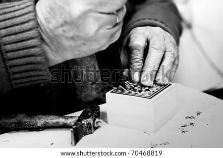 Black and white taracea craftsman - stock photo
