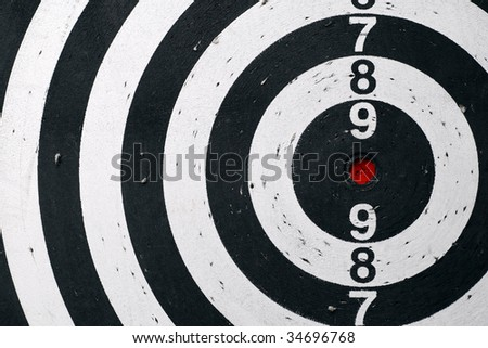 Black and white target sheet with red target. - stock photo