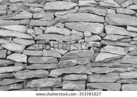Black and white tone stone wall,The walls are made of stone - stock photo